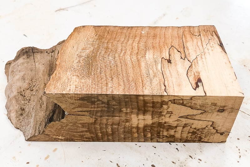 testing various finishes on scrap piece of live edge board