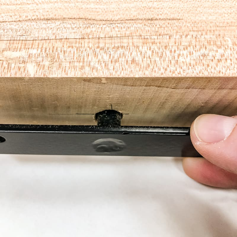 checking fit of floating shelf hardware in hole