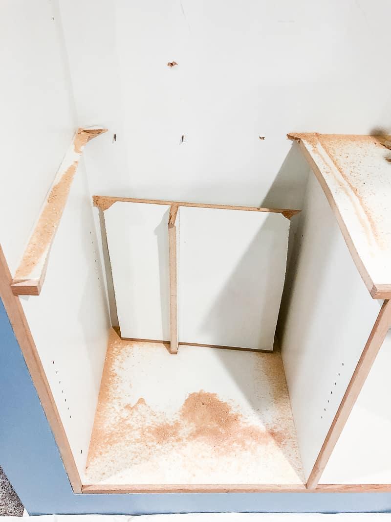 shelves of built in entertainment center cut apart