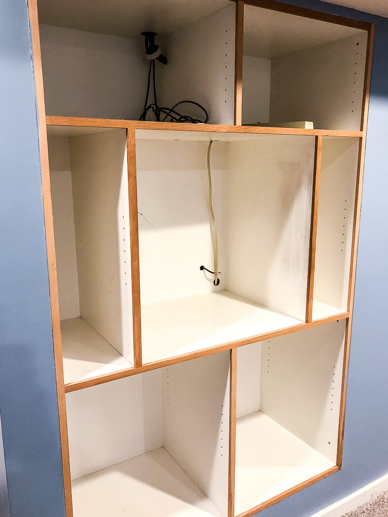 built in entertainment center with shelves