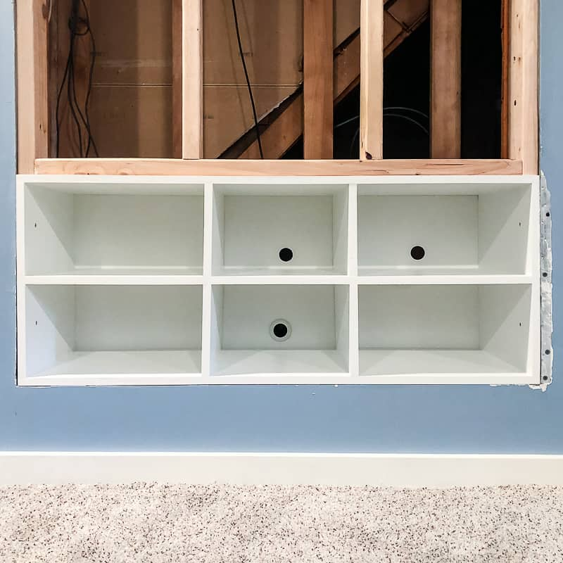 built in entertainment center shelves installed in opening in wall