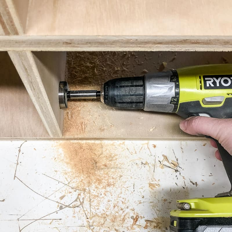 drilling hole in shelf divider for cables