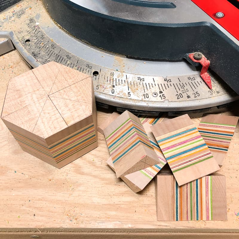 miter saw set to 30 degrees to cut hexagon shape for DIY candle holder