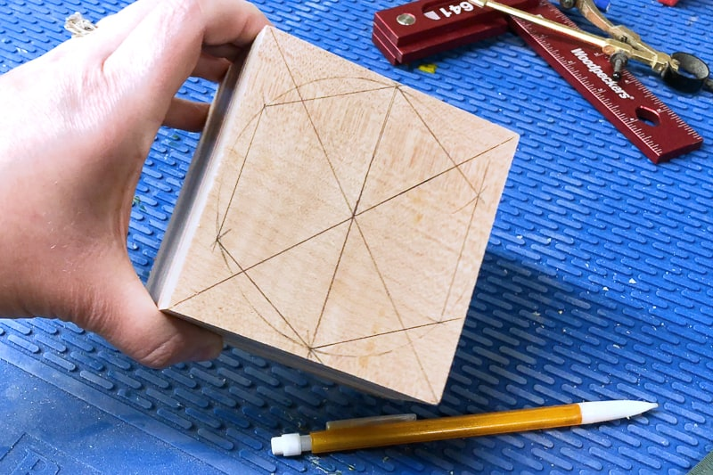 hexagon drawn on top of DIY wood candle holder