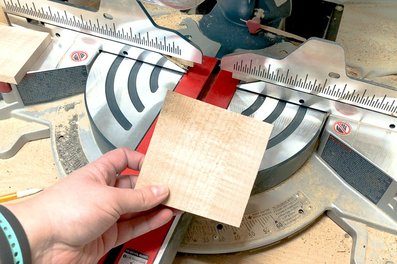 square of curly maple cut on the miter saw