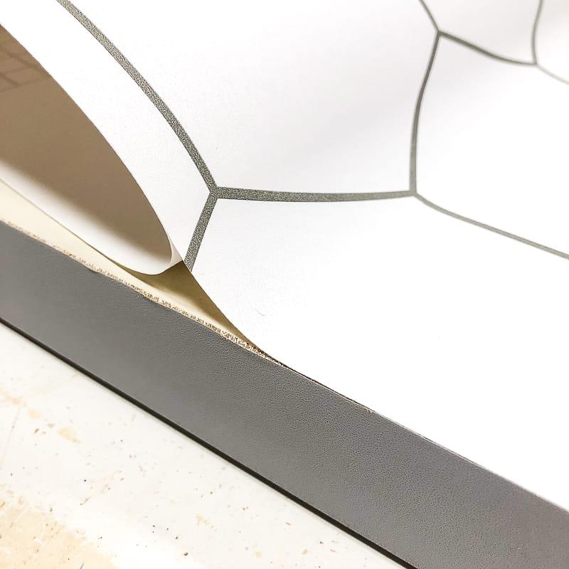 applying hexagon patterned contact paper to bifold door