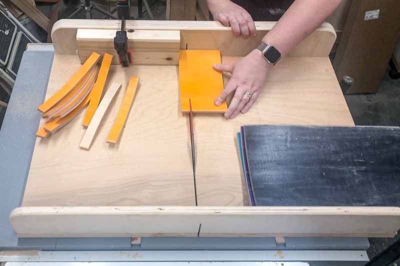 cutting strips of skateboard on a crosscut sled with the table saw