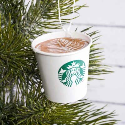 DIY Starbucks ornament hanging on a Christmas tree