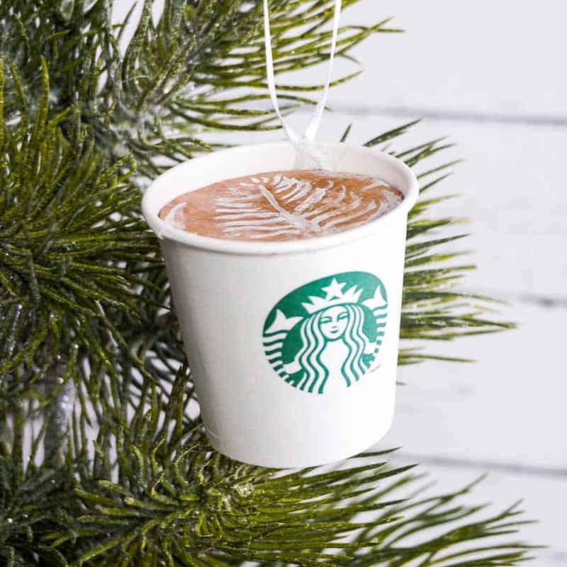 DIY Starbucks ornament hanging on a Christmas tree