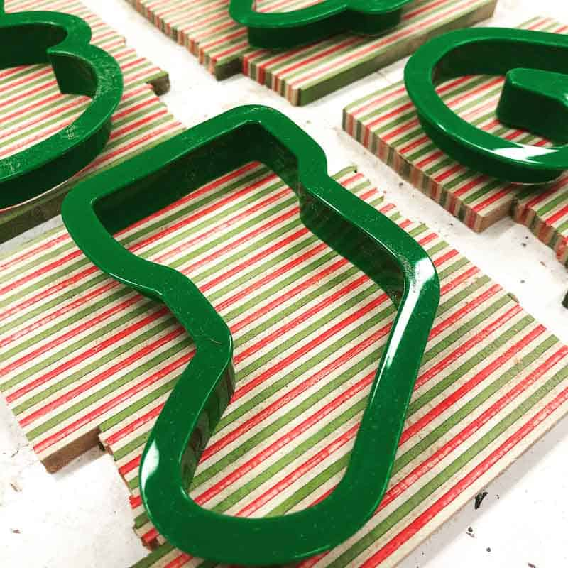 cookie cutters used as stencils for wooden ornaments