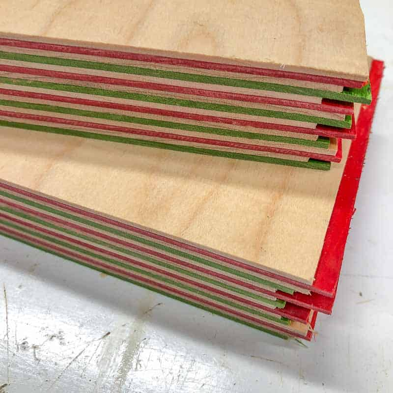 """two 1"""" stacks of dyed wood veneer for wooden ornaments"""