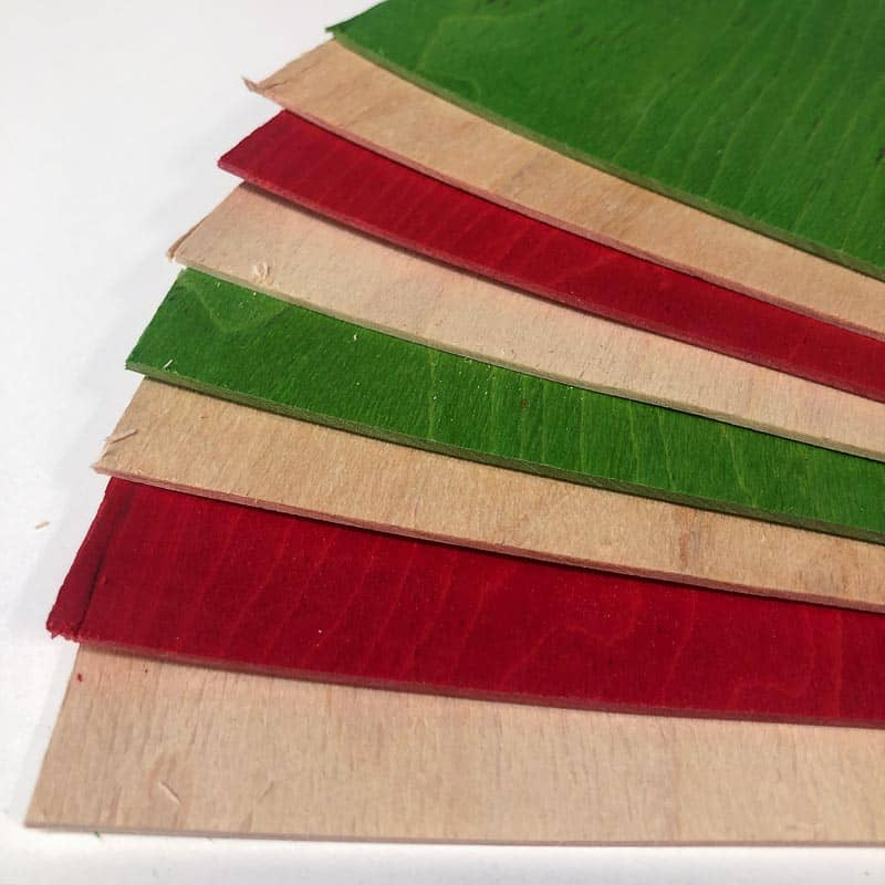 layers of red, green and natural colored veneer for wooden ornaments