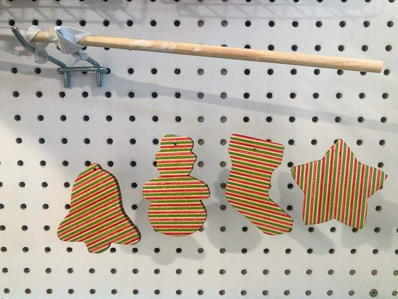 hanging wooden ornaments from a dowel to dry