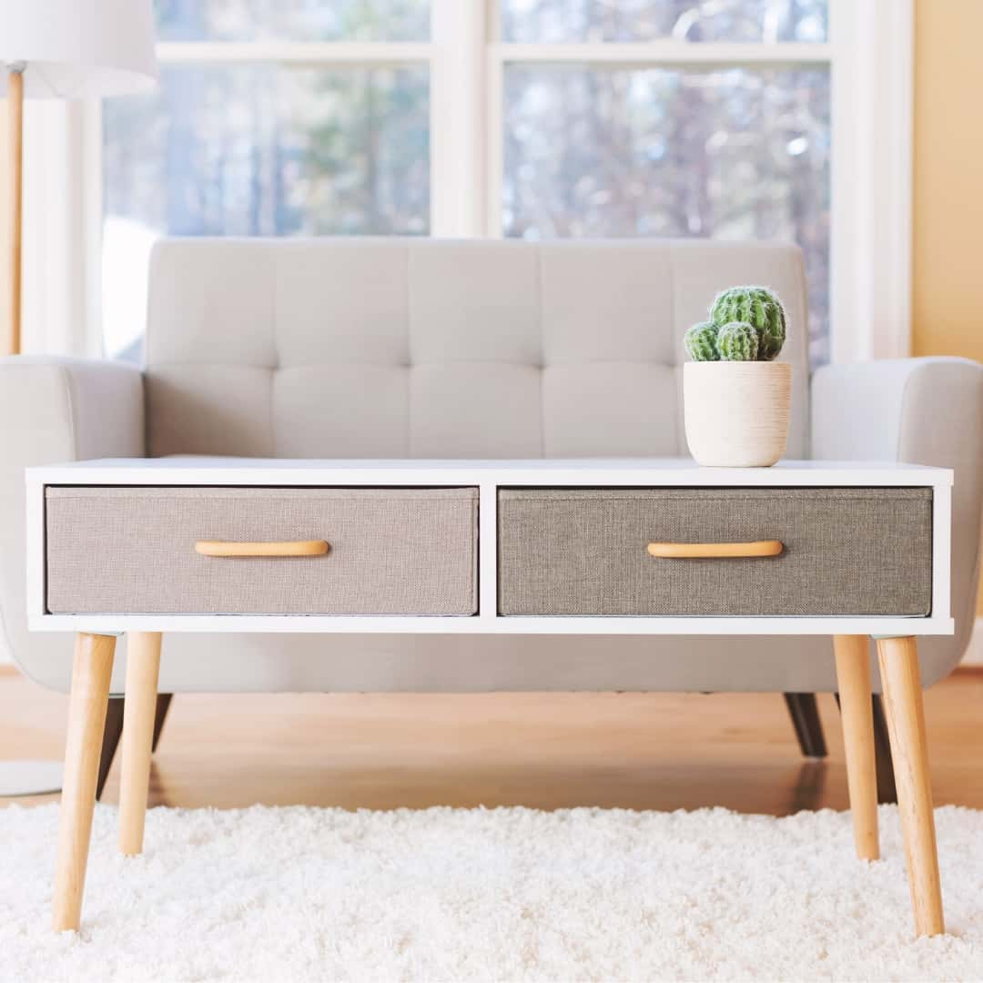 midcentury modern coffee table with angled legs screwed into place with hanger bolts