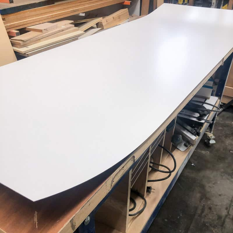 cut laminate sheet on workbench
