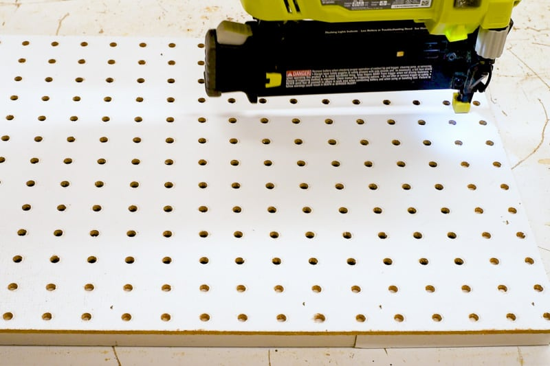 nailing supports for pegboard in place