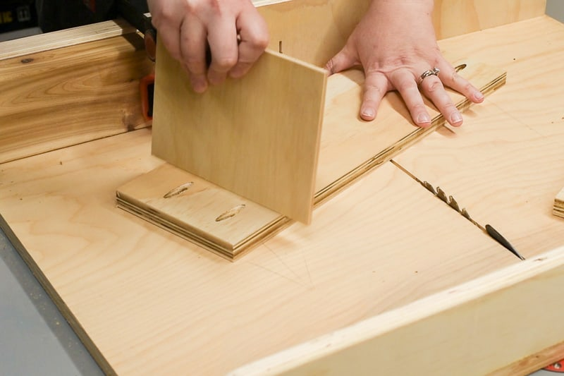 testing fit of dividers in groove of DIY drawer organizer