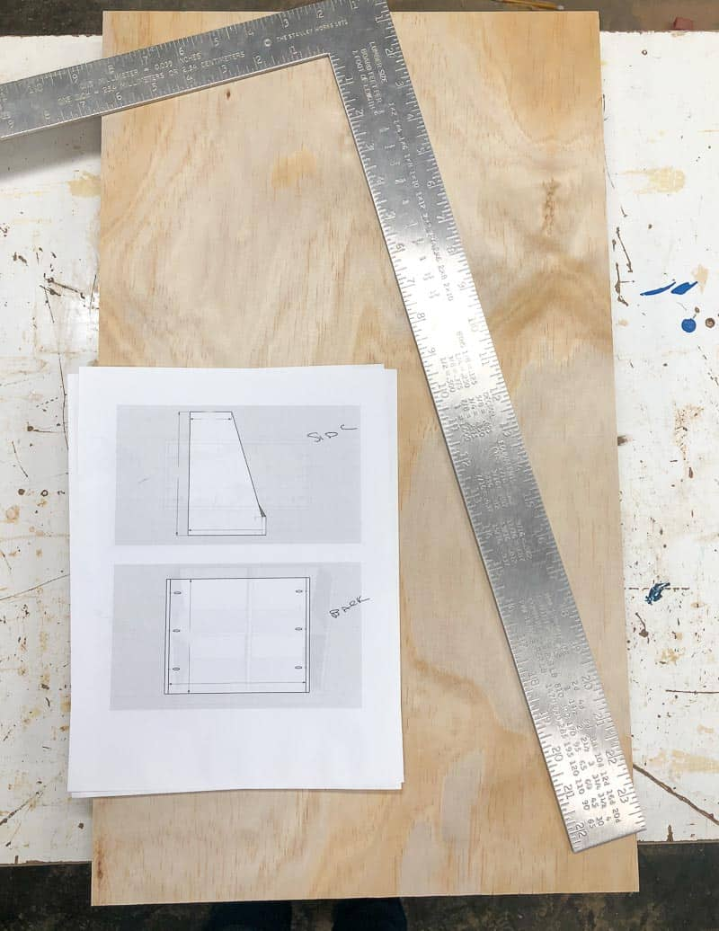 measure and mark the angled side of the DIY bookshelf according to the plans