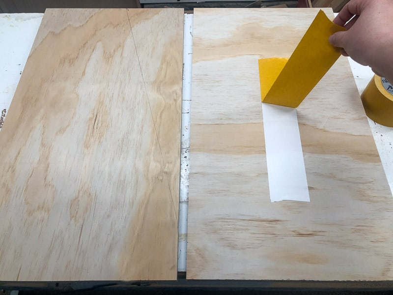 applying double stick tape to bookshelf sides before cutting the angle