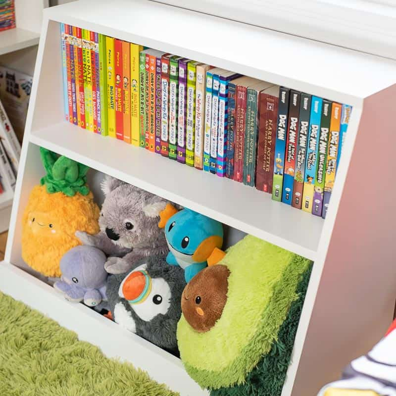 side view of DIY kids bookshelf filled with books and stuffed animals