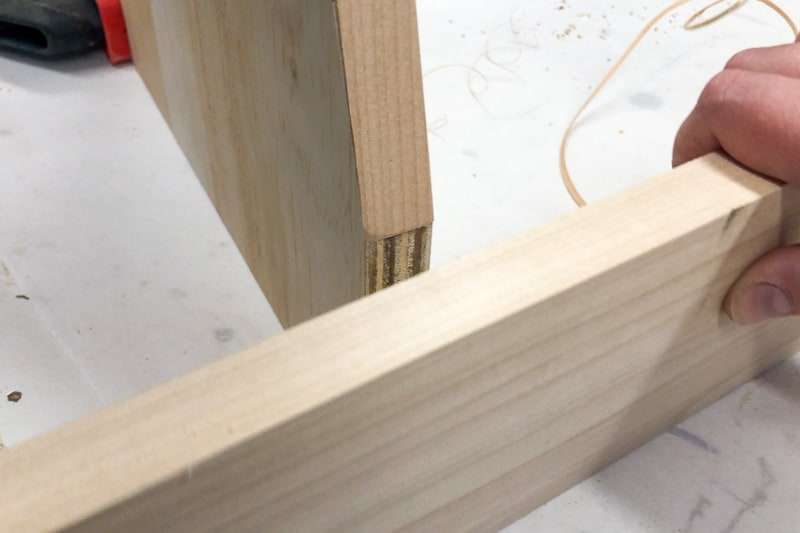 testing fit of front piece of bookshelf after applying edge banding