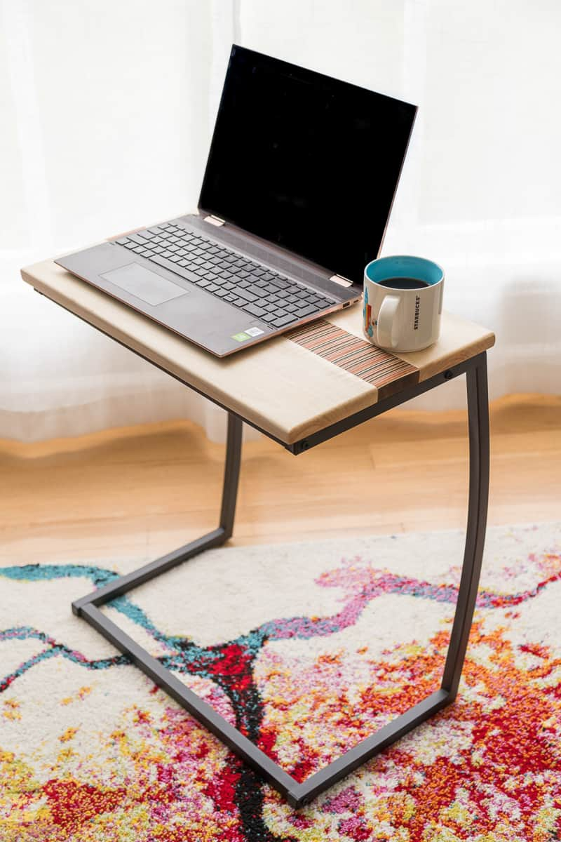 DIY laptop stand top on metal base with laptop and coffee cup