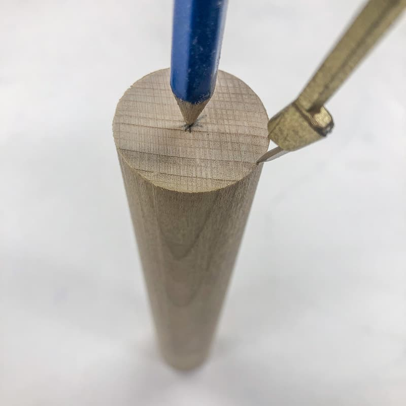 marking the center of a wooden dowel end with a compass