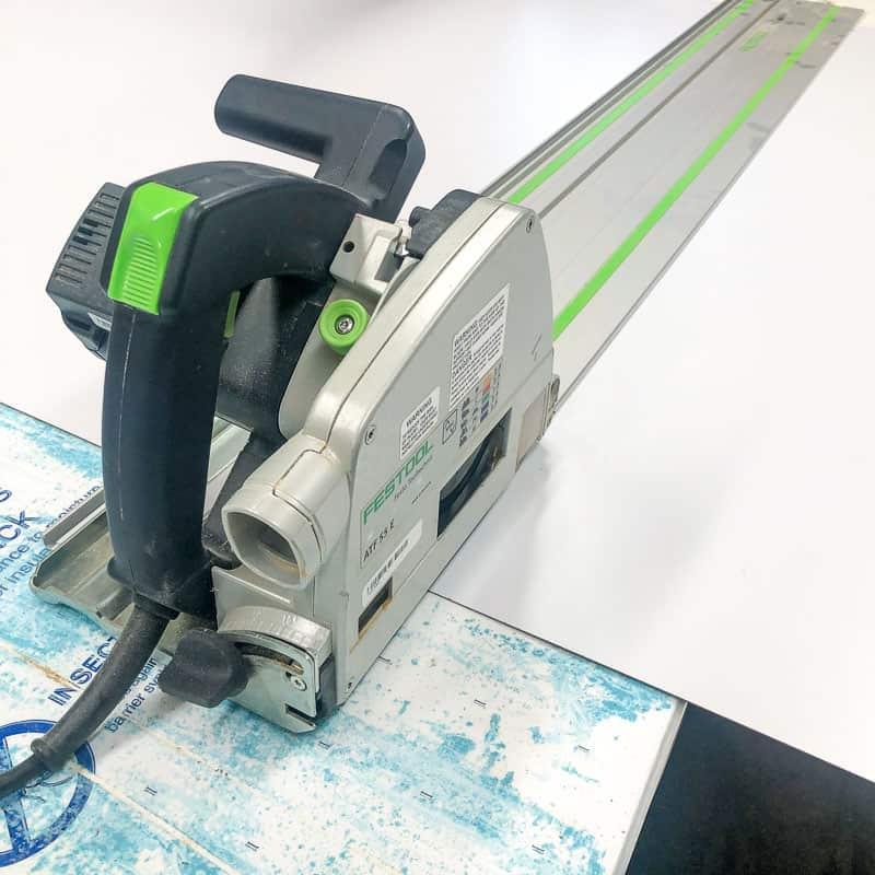 Festool track saw on laminate sheet and foam insulation panel