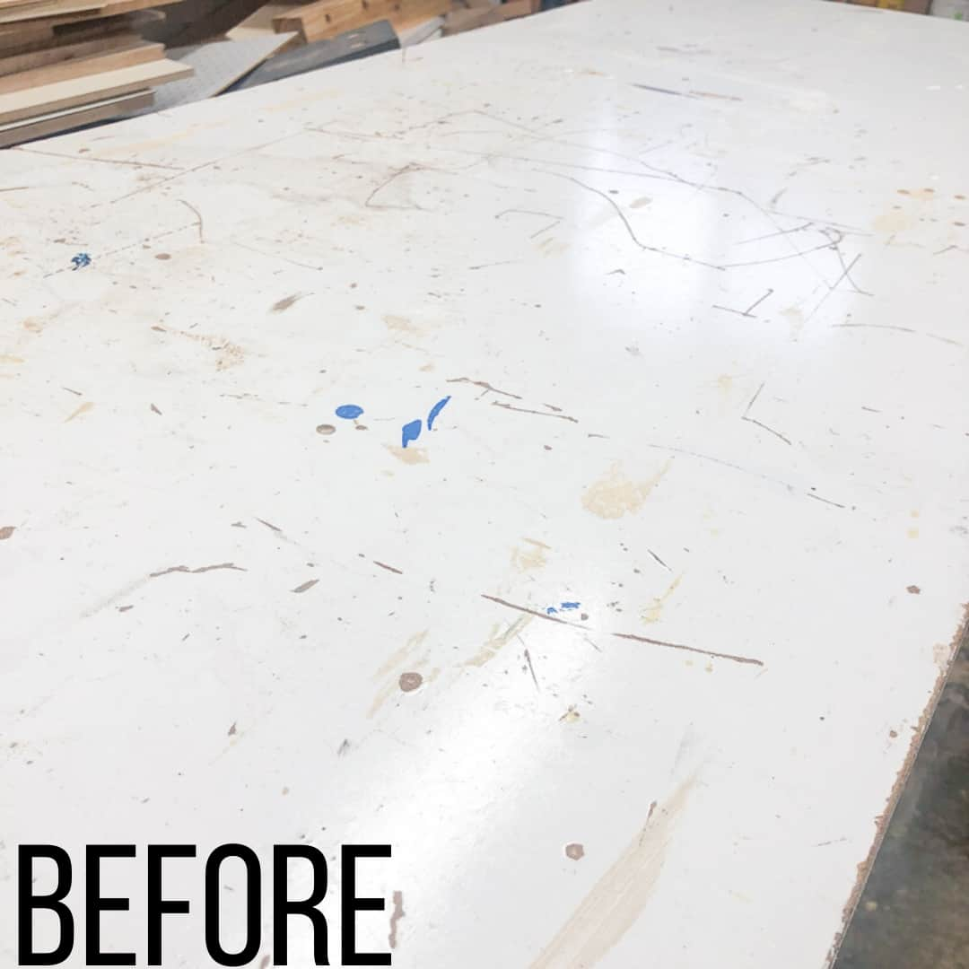 workbench top with scratches and paint drips