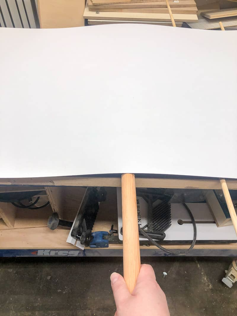removing wooden dowel under laminate sheet