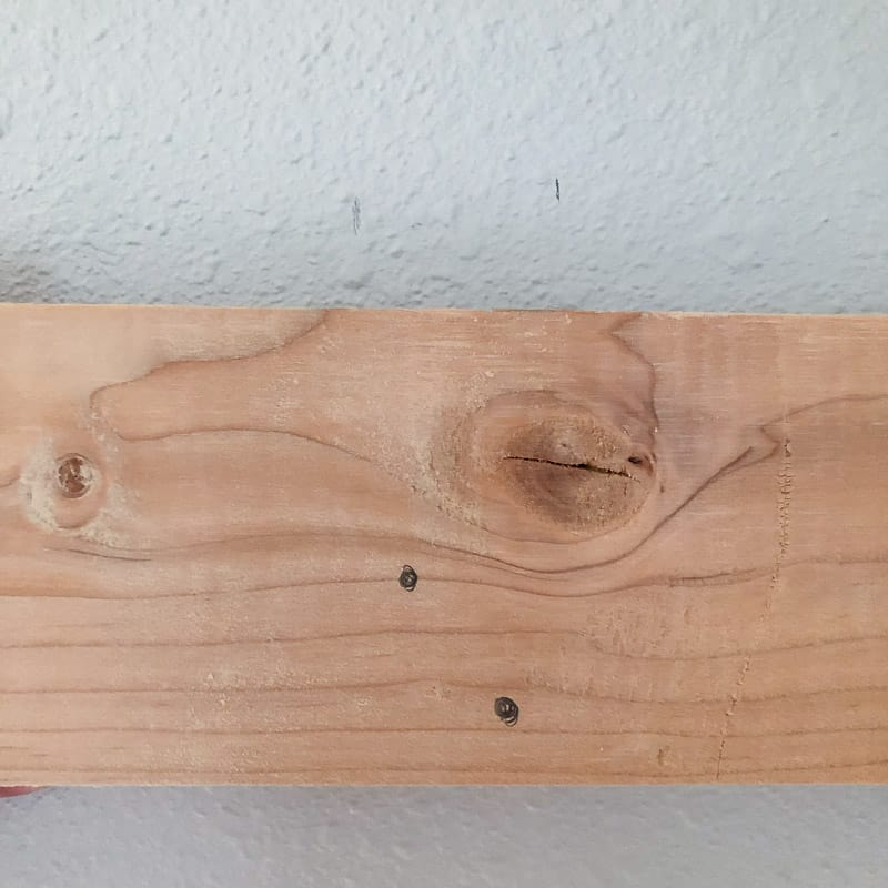 marking French cleat for holes by comparing to studs in the wall