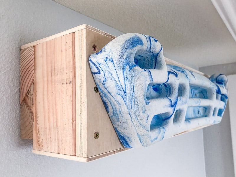 French cleat holding hangboard on wall