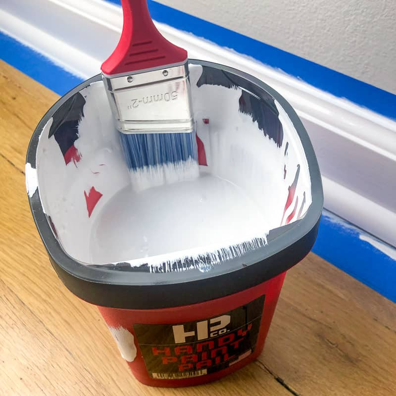 trim paint in Handy paint pail with paint brush attached to magnet on side