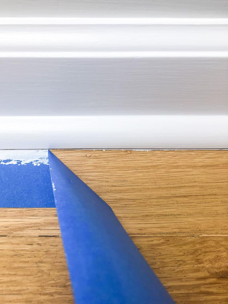 paint on hardwood floor under baseboards