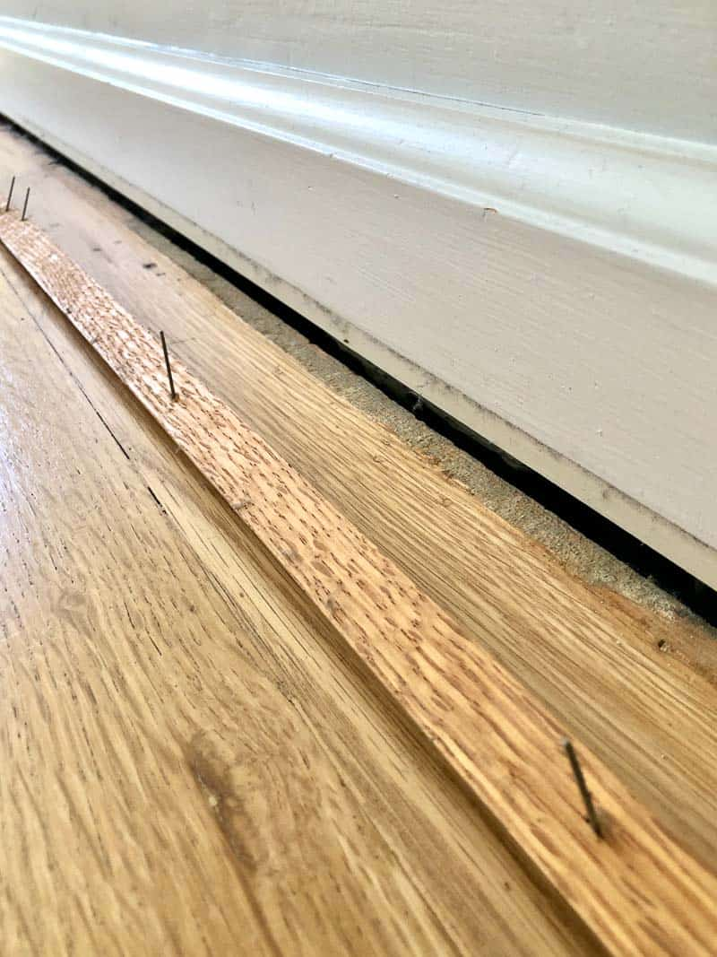 oak quarter round trim removed from baseboards