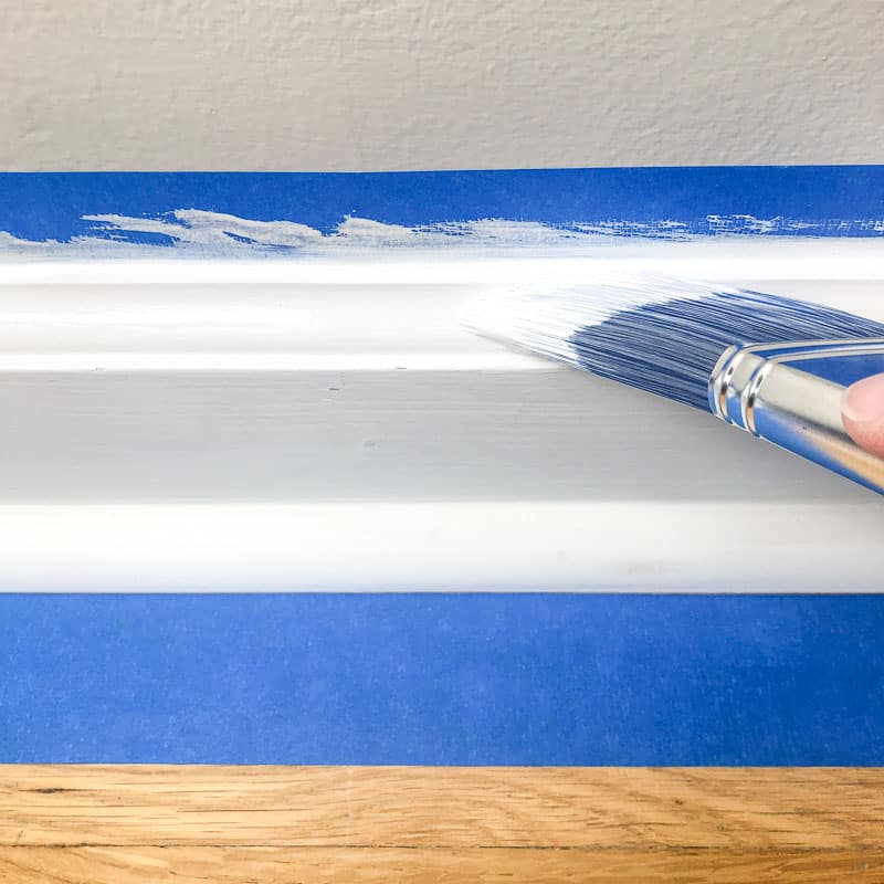 painting the decorative edge of the baseboards