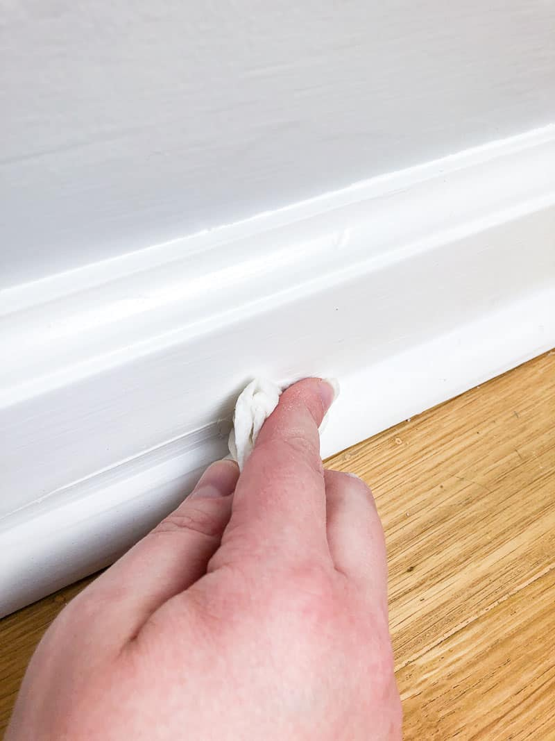 smoothing caulk line with finger