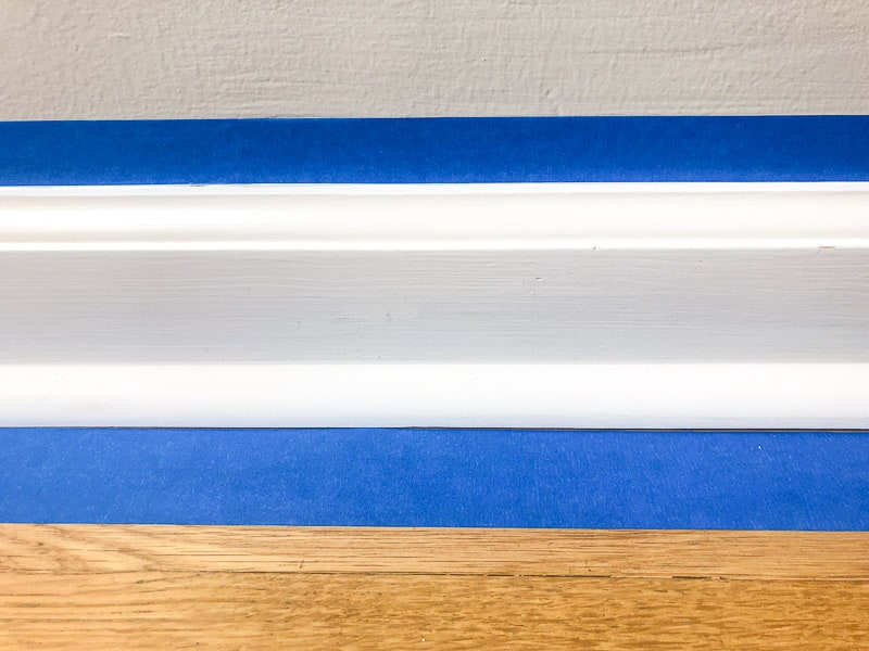 painter's tape above and below baseboards