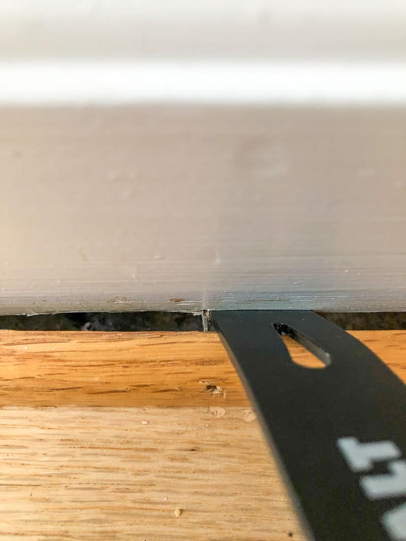 using the flat end of a small pry bar to remove quarter round trim