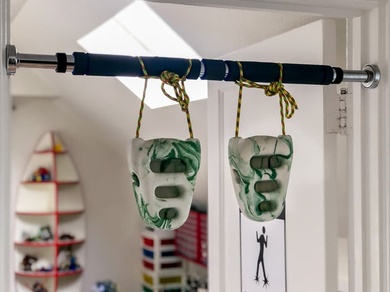 Rock rings tied to a pull up bar across a doorway