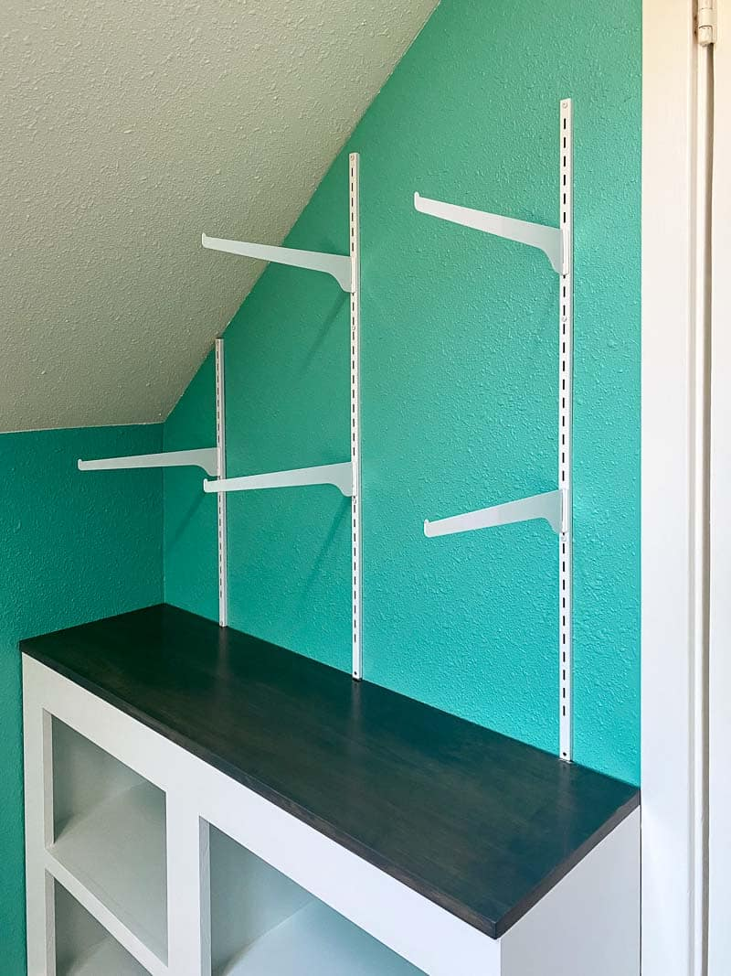 adjustable wall mounted shelves with brackets installed