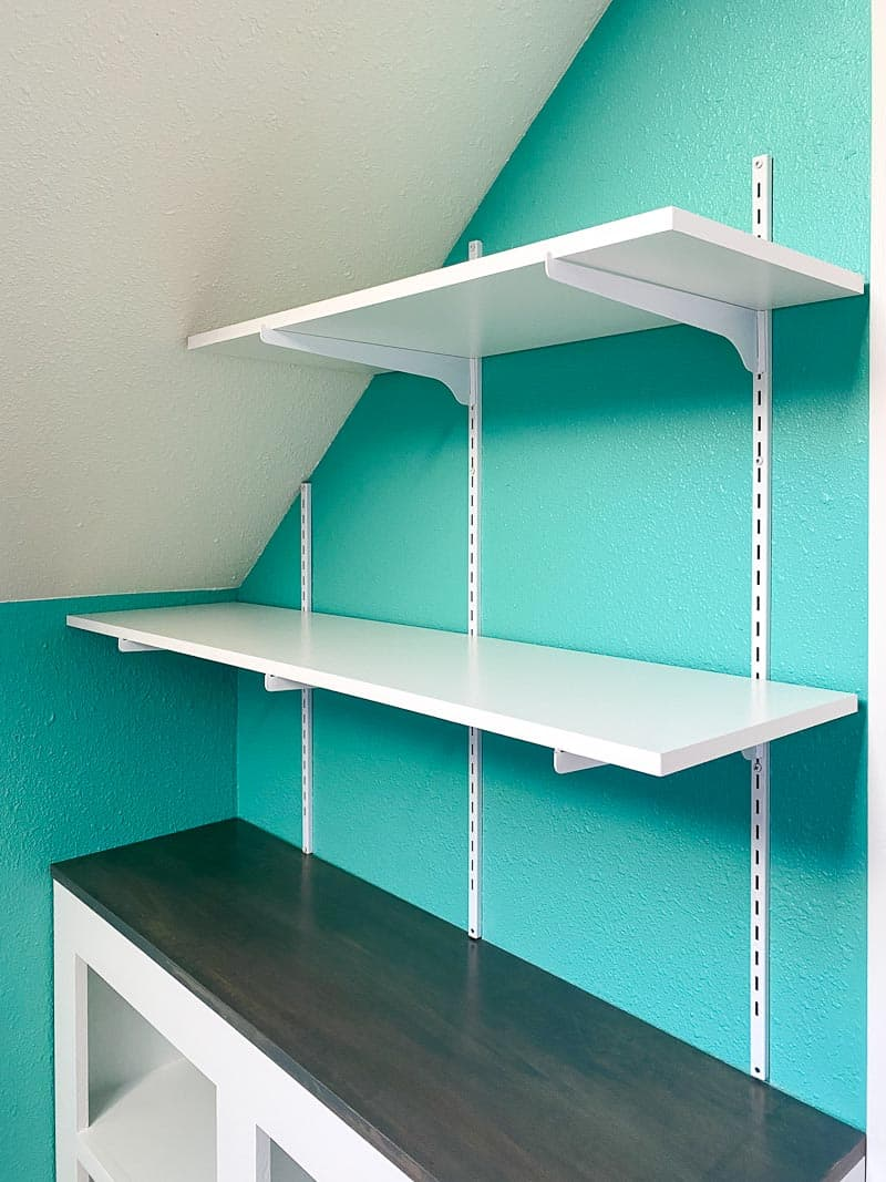 adjustable wall mounted shelves installed on sloped wall