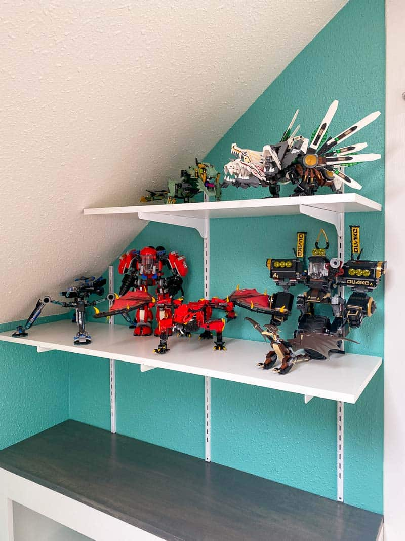 adjustable wall mounted shelving with Lego builds on display