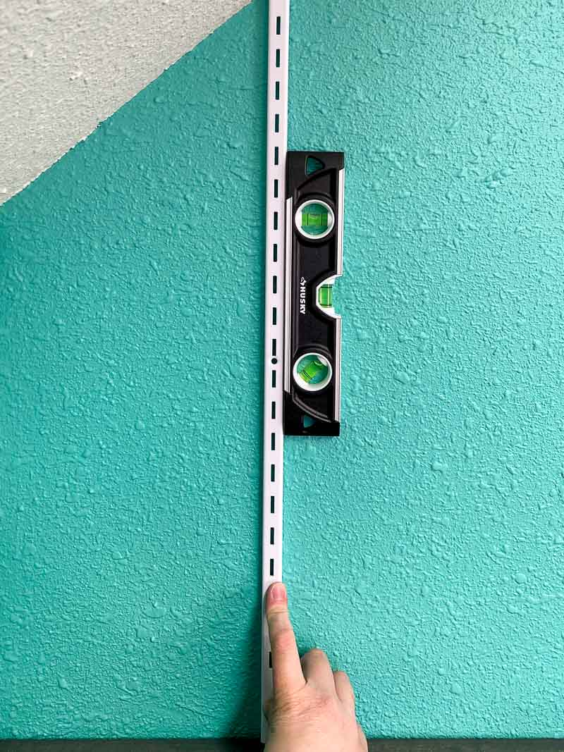 magnetic level attached to metal adjustable shelf standard