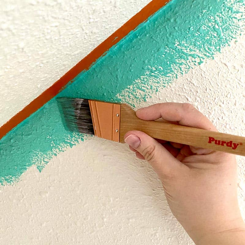 painting textured walls with Purdy paint brush
