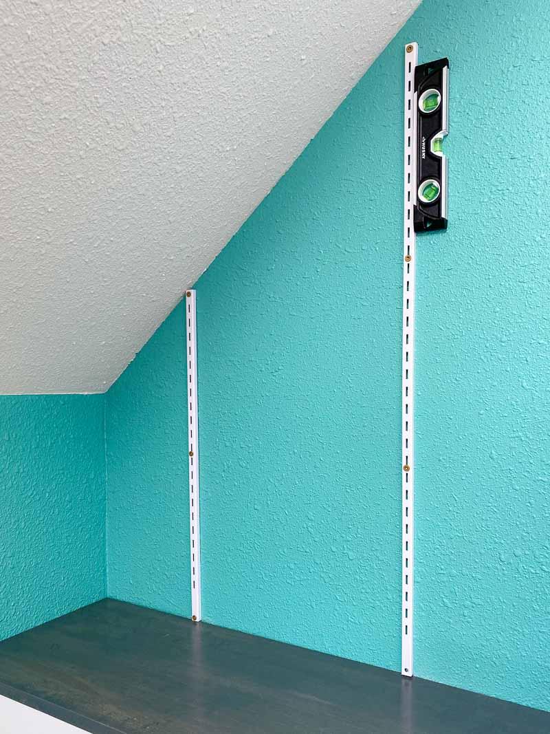Adjustable wall mount shelves on angled wall