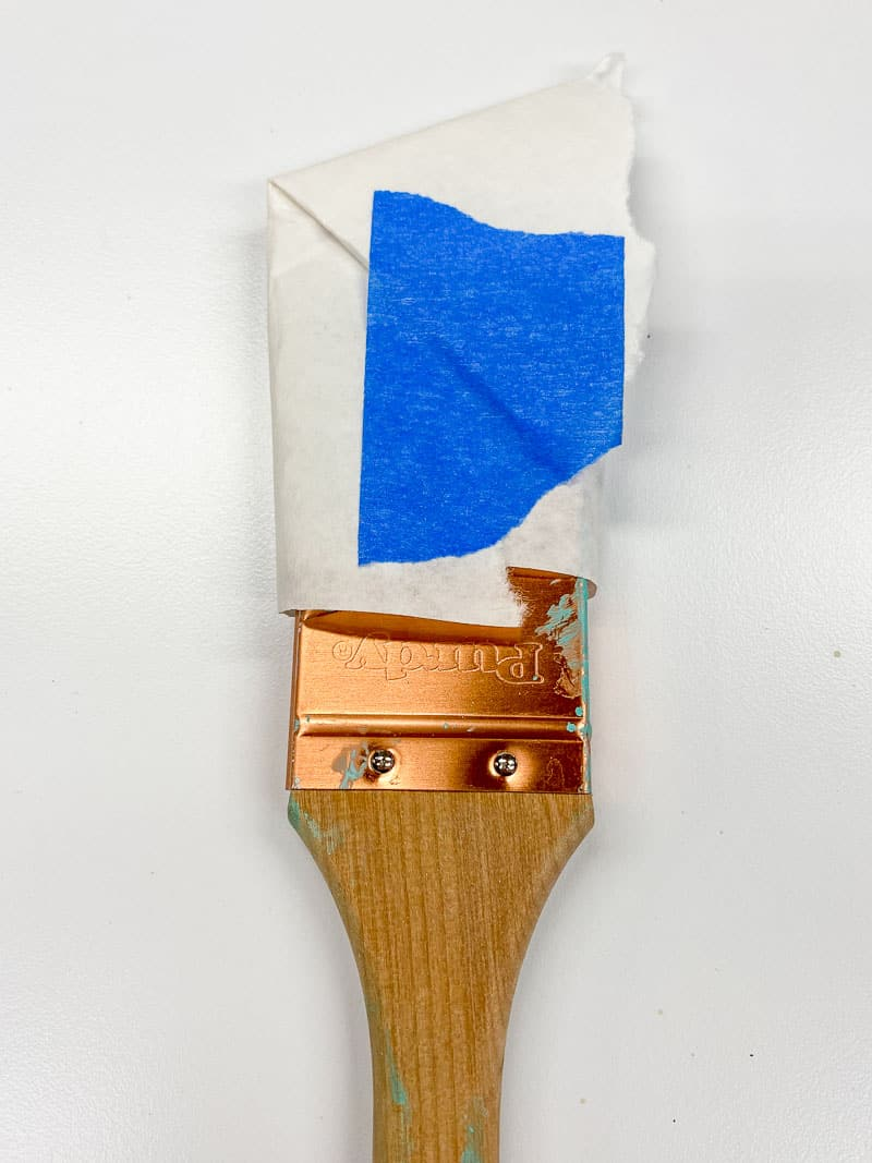 paint brush wrapped in paper after cleaning