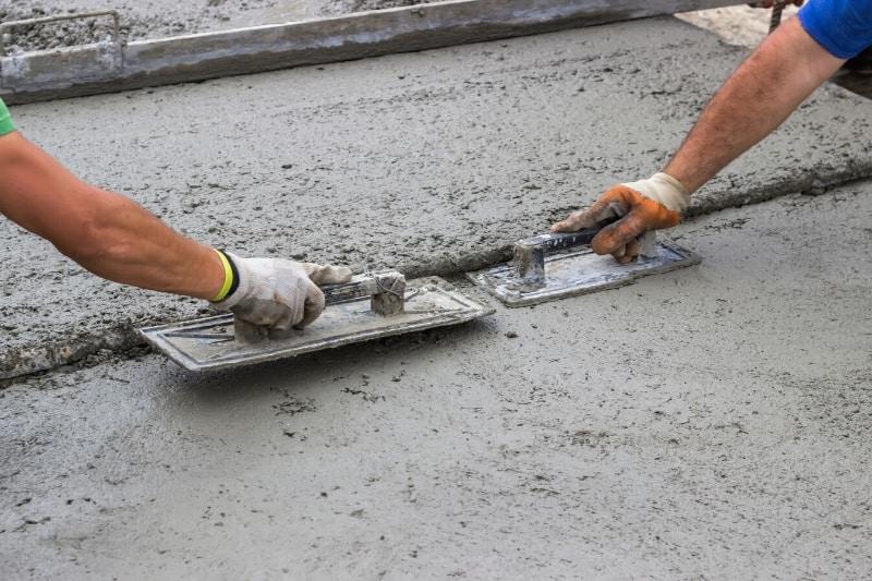 spreading a concrete patio