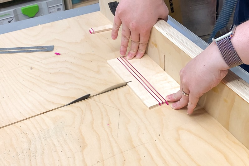 cutting out wood coasters on a table saw crosscut sled