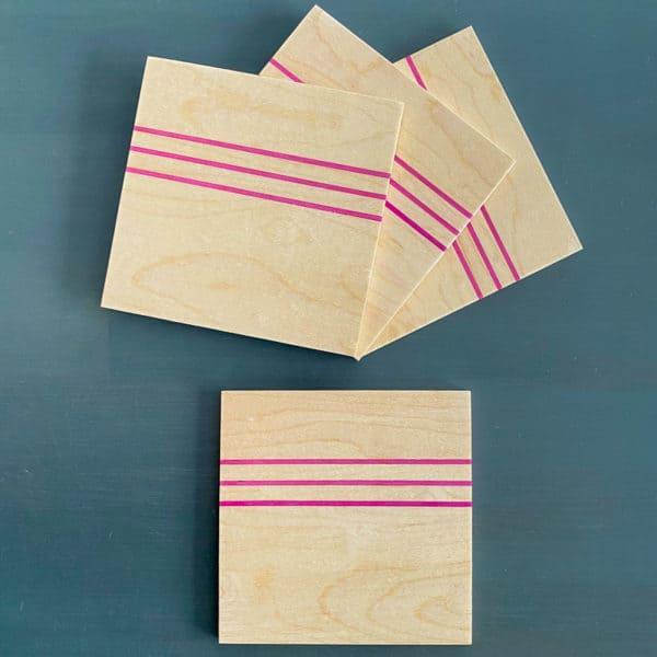 DIY wood coasters with skateboard veneer stripes